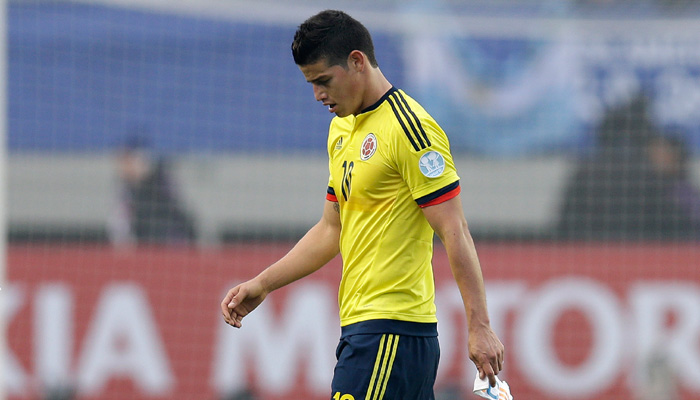 Colombia's James Rodriguez leaves the pitch at the end of a Copa America Group C soccer match against Peru at the Bicentenario German Becker stadium in Temuco, Chile, Sunday, June 21, 2015. The game ended in a 0-0 draw. (AP Photo/Natacha Pisarenko)