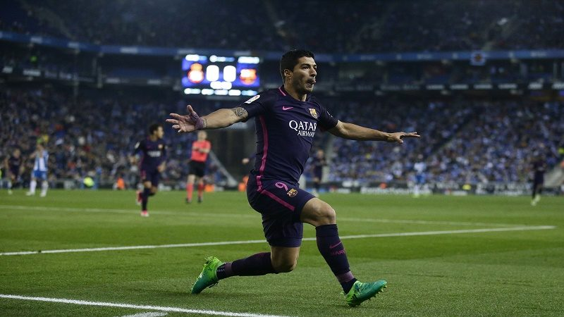 FC Barcelona's Luis Suarez reacts after scoring during the Spanish La Liga soccer match between Espanyol and FC Barcelona at RCDE stadium in Cornella Llobregat, Spain, Saturday, April 29, 2017. (AP Photo/Manu Fernandez)