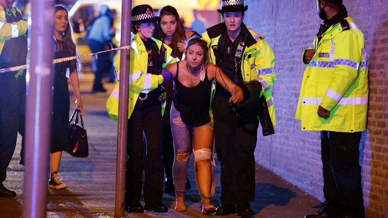 Manchester, UK. Police and other emergency services are seen near the Manchester Arena after reports of an explosion. Police have confirmed they are responding to an incident during an Ariana Grande concert at the venue. Reported Explosion at Manchester Arena, UK - 22 May 2017 (Rex Features via AP Images)