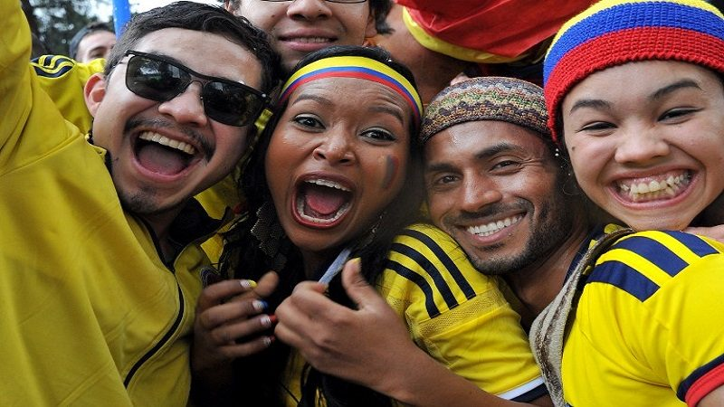Colombian fans celebrate during the fan fest in Bogota, on June 28, 2014 as they watch the FIFA World Cup Brazil 2014 second round match between Colombia and Uruguay in a big screen. Colombia won 2-0 and reached the quarter-finals.  AFP PHOTO/Guillermo LEGARIA