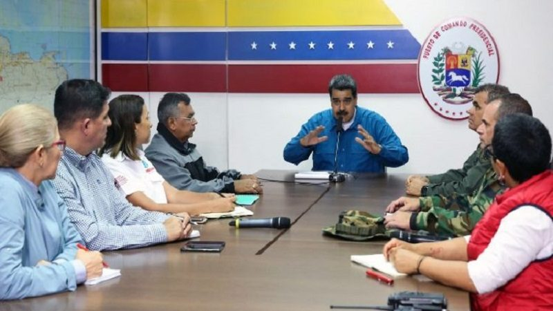 "This handout photo released by Venezuelan Presidency shows Venezuela's President Nicolas Maduro (C) and Defense Minister Vladimir Padrino (R) along with other members of the government, announcing a 30-day electricity rationing plan, at the Miraflores Palace in Caracas, on March 31, 2019. - Venezuelan President Nicolas Maduro on Sunday announced a ""30-day plan"" to ration power in the country, which has been hit by repeated electricity blackouts over the past month. The emphasis of the plan -- which Maduro announced on state television -- will be ""guaranteeing water service,"" the embattled president said. (Photo by HO / Venezuelan Presidency / AFP) / RESTRICTED TO EDITORIAL USE - MANDATORY CREDIT ""AFP PHOTO - Venezuelan Presidency"" - NO MARKETING NO ADVERTISING CAMPAIGNS - DISTRIBUTED AS A SERVICE TO CLIENTS"